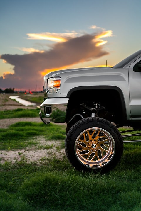Lifted truck with custom wheels