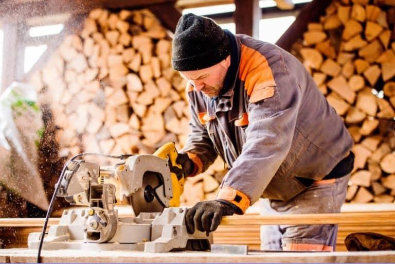 Man using miter saw to cut wood