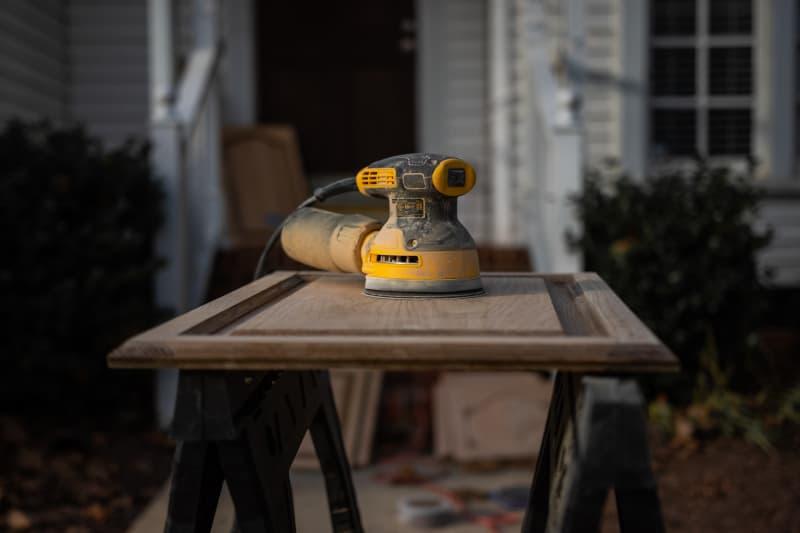 Orbital sander used to prep wood for refinishing